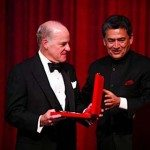 Henry Kravis Founding Partner KKR receiving award from Rajat Gupta AIF Co-Chair