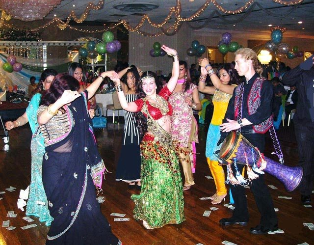 Bollywood moves - The Dancing Princess interacts with guests at an Indian celebration