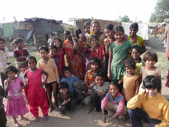 Akash with children in a Bhopal slum affected by the gas leak