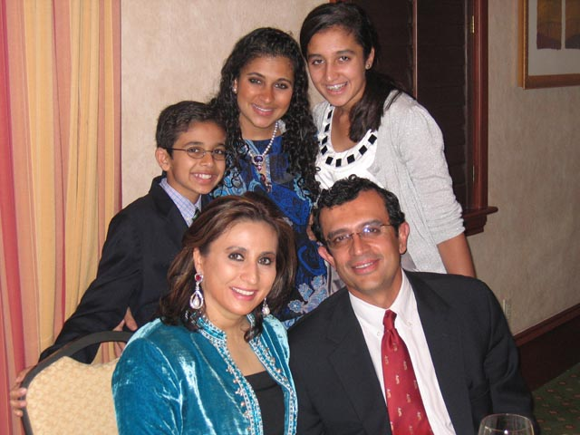 Meera and Vikram Gandhi with their children