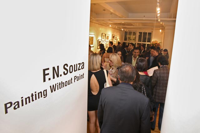 Gallery visitors view art by F.N.Souza