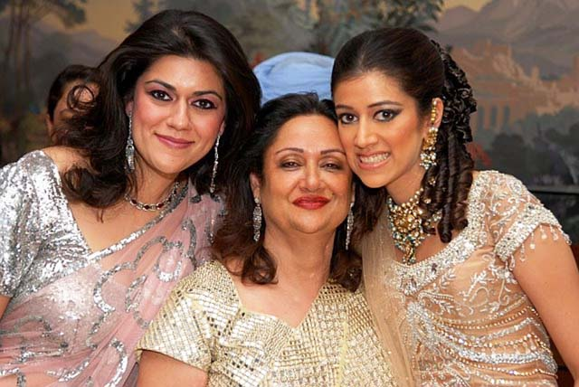 Asema (R) with sister and mother