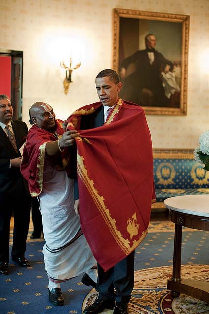 President Barack Obama receives a red shawl from Sri Narayanachar Digalakote, a Hindu priest from Sri Siva Vishnu Temple, located in Lanham, Md., in the Blue Room of the White House, prior to the Asian American and Pacific Islander Initiative Executive Order signing, and Diwali festival of lights ceremony, Oct. 14, 2009. (Official White House Photo by Pete Souza