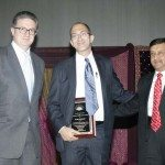 Consul General Prabhu Dayal presents the Making a Difference Award to Mark Templer of Hope Worldwide. The award was sponsored by HSBC Private Bank, represented by Michael Mount.