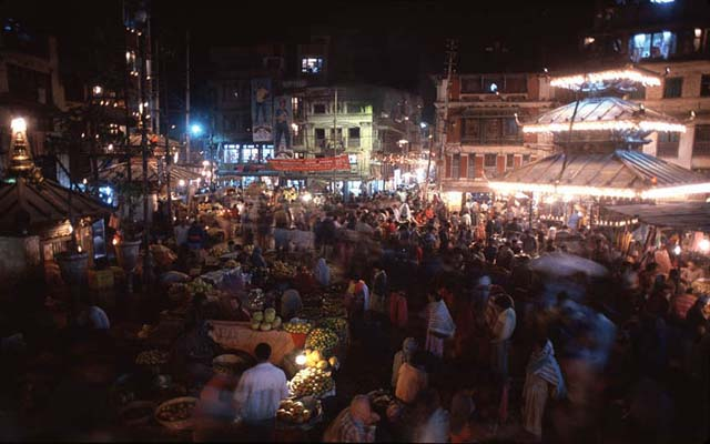 A swirl of trade around the Annapurna and Ganesh Temples swells on the open market of Asan Tol a major stop on the Tibet-Kathmandu-India trading center. Kathmandu, Nepal.