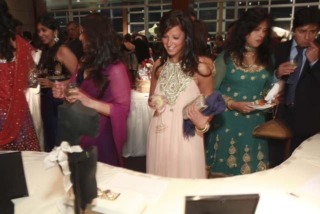 Guests bid on luxury items at Children's Hope Royal India Gala