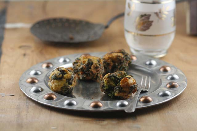 Vikas Khanna of Junoon is the new host of Master Chef and author of 'Flavors First' in which this recipe for Plantain and Spinach Fritters is featured.