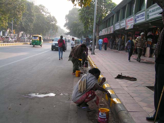 India Blog - Women workers painting traffic markings in New Delhi, India