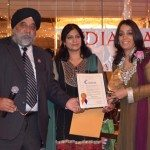 Indian American Forum honored women during Women's History month.Mohinder Taneja and Sukhwinder Ranu present award to Chanbir Kaur