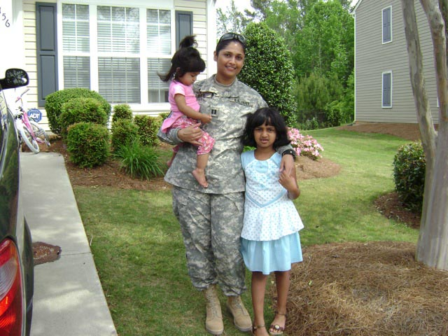 Pratima Dharm is the first Hindu chaplain in the US Army. She is seen here with her daughters