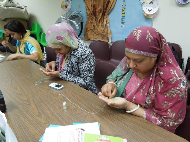 South Asian immigrant women learning a craft at Wishwas