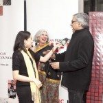 Aroon Shivdasani and Aseem Chhabra being interviewed by reporter Subhi Khanna on the red carpet at NYIFF