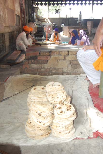 members of the Sikh community prepare langar at the Golden Temple