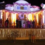 At an Indian wedding, couple and family gather on the stage