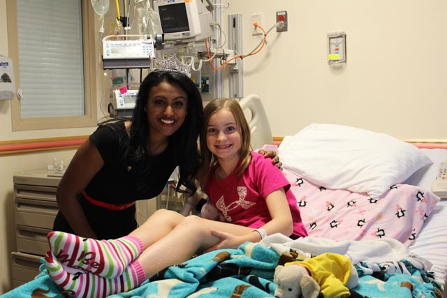 Nina Davuluri with a young patient