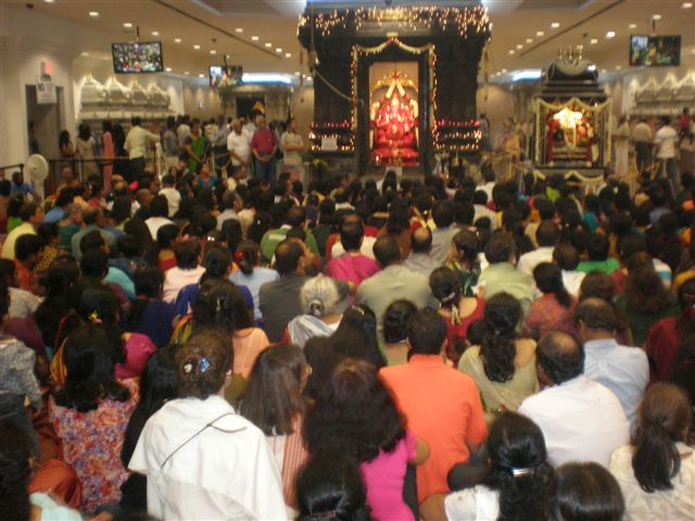 Devotees worshipping at the Hindu temple