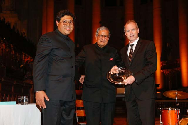 Arvind Raghunathan and Victor Menezes with George R. Oliver, CEO of Tyco International