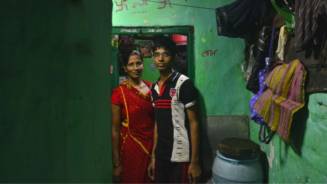 Bachchi Devi and Niraj outside their house.(Devjyot Ghoshal/Quartz)