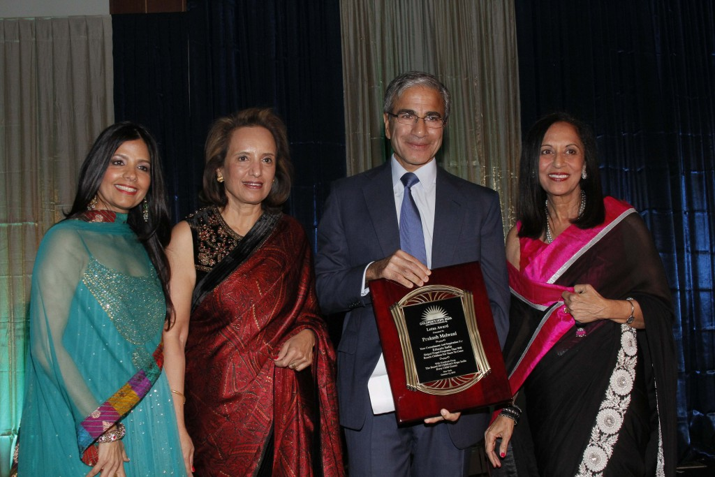Lotus Award Honoree Prakash Melwani is flanked by emcee Tinku Jain, CHI co-founder Dina Pahlajani and CHI president Maya Rajani