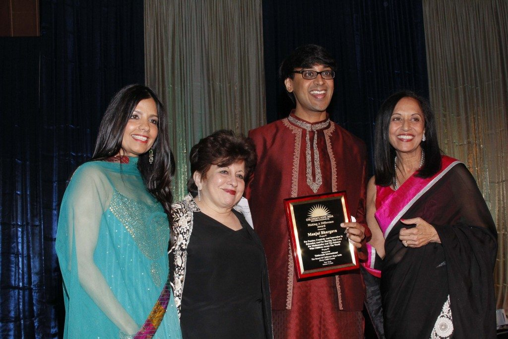 . Honoree Manjul Bhargava with emcee Tinku Jain, CHI co-founder Lavina Melwani and CHI president Maya Rajani