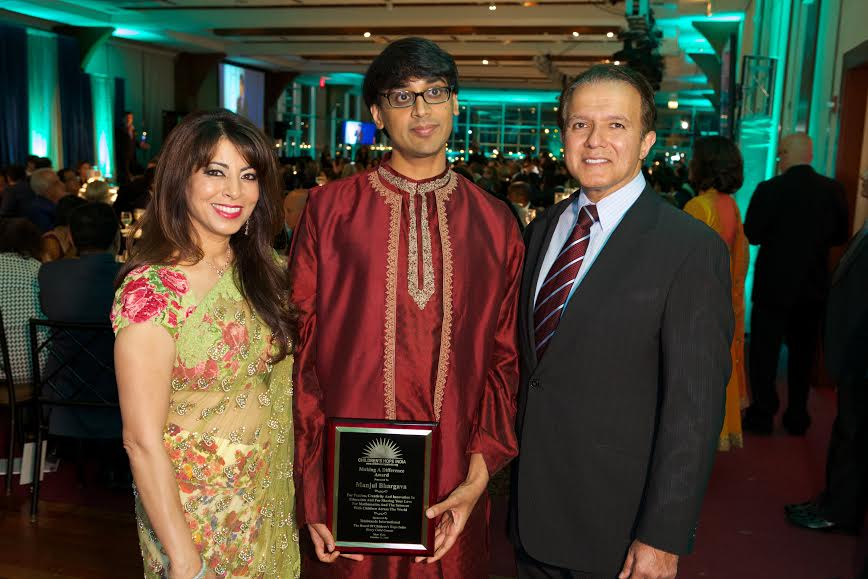 Manjul Bhargava with Poonam and AJ Khubani, Sponsors of the Making a Difference Award