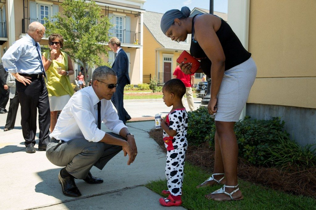 """Nice pajamas. The President greets residents in the Tremé neighborhood of New Orleans. The area experienced significant flooding during Hurricane Katrina ten years ago, and much of it has been rebuilt."" (Official White House Photo by Pete Souza)"