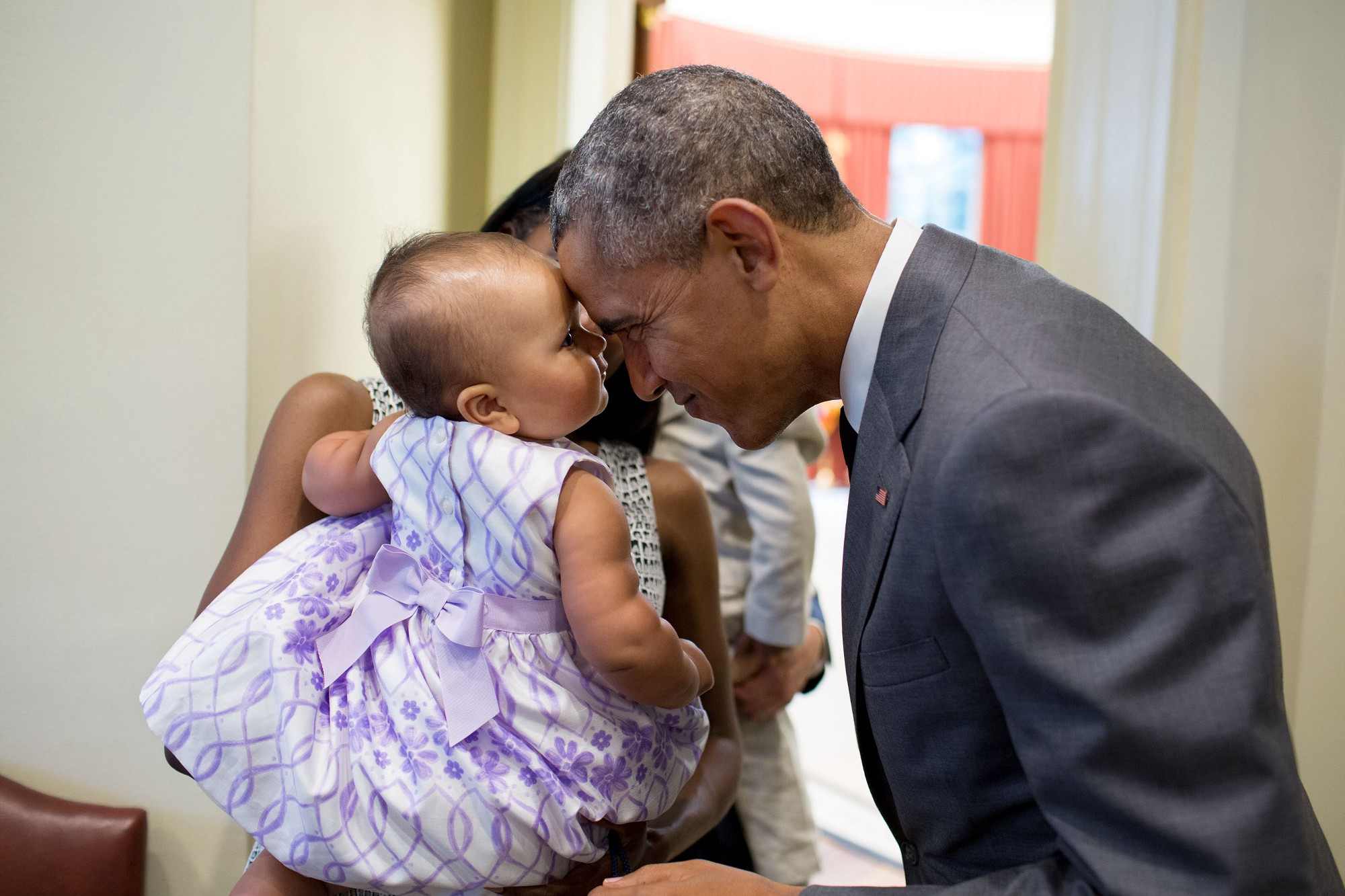 "The President greets nine-month-old Josephine Gronniger, whose father, Tim Gronniger, brought his family by the Oval Office for a family photo."" (Official White House Photo by Pete Souza)"