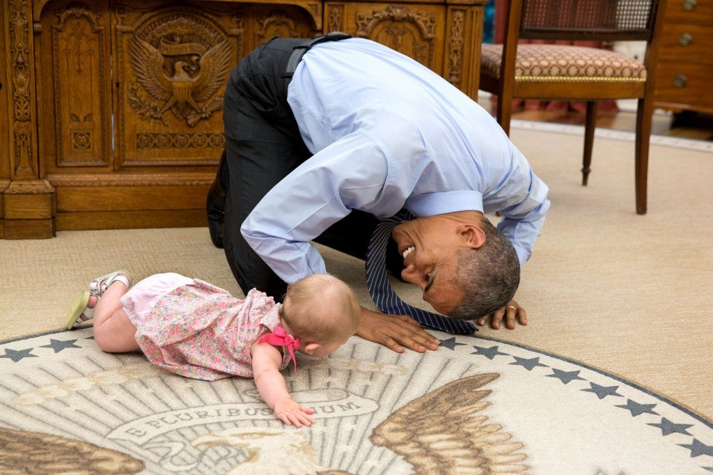 """At the President's insistence, Deputy National Security Advisor Ben Rhodes brought his daughter Ella by for a visit. As she was crawling around the Oval Office, the President got down on his hands and knees to look her in the eye."" (Official White House Photo by Pete Souza)"