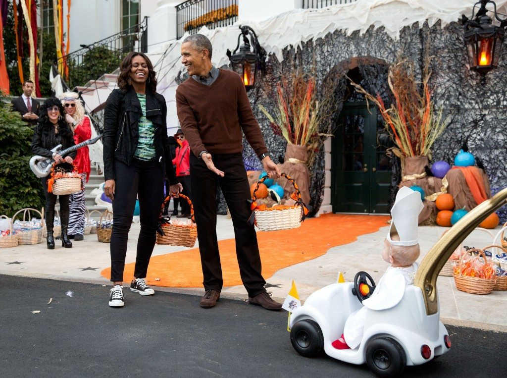 """The President and First Lady react to a child in a pope costume and mini popemobile as they welcomed children during a Halloween event on the South Lawn of the White House."" (Official White House Photo by Pete Souza)"