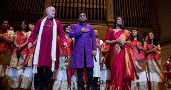 Faculty members Eugene Friesen and Annette Philip flank A.R. Rahman during final bows at the end of the October 24 concert. Performers from the Berklee Indian Ensemble stand in the back row.