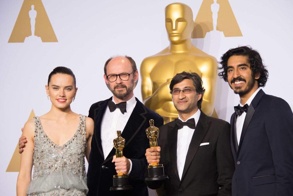 """James Gay-Reese and Asif Kapadia pose backstage with the Oscar® for Best Documentary Feature, for work on """"Amy"""", with Daisy Ridley and Dev Patel during the live ABC Telecast of The 88th Oscars® at the Dolby® Theatre in Hollywood, CA on Sunday, February 28, 2016."""