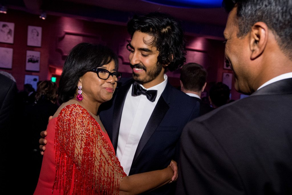 """Academy President Cheryl Boone Isaacs and Dev Patel at the Governors Ball with the Oscar® for Achievement in directing, for work on """"The Revenant"""" during the live ABC Telecast of The 88th Oscars® at the Dolby® Theatre"""