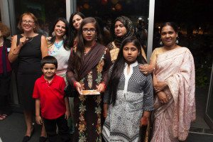Surbhi Sahni with Alison Karasz, director of the Tiffin Project, immigrant women trainees and their families at a Sapna NYC fundraiser.