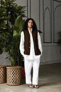Deep earthen cotton and linen knit Nehru vest, white cotton slubduofold shawl kurta, white reverse loopback terry pleated patiala pajama sweatpant.