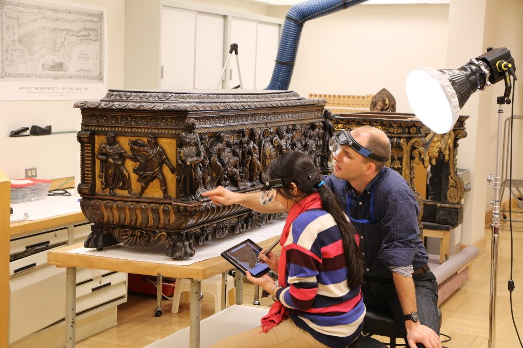 "1.Nidhi Shah—ChhatrapatiShivajiMaharajVastuSangrahalaya (CSMVS), Mumbai—with furniture conservator Daniel Hausdorf, while documenting the condition of an Italian mid-sixteenth century carved and partially gilded cassone with nineteenth century additions. She divided her residency between the Metropolitan Museum and the Stichting Restauratie Atelier Limburg (SRAL) in the Netherlands. As part of her program for professional training, ""Systems and Procedures for Art Conservation,"" Ms Shah developed a template for tablet-based digital documentation."