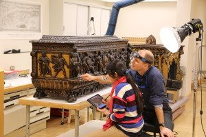 """1. Nidhi Shah—ChhatrapatiShivajiMaharajVastuSangrahalaya (CSMVS), Mumbai—with furniture conservator Daniel Hausdorf, while documenting the condition of an Italian mid-sixteenth century carved and partially gilded cassone with nineteenth century additions. She divided her residency between the Metropolitan Museum and the Stichting Restauratie Atelier Limburg (SRAL) in the Netherlands. As part of her program for professional training, """"Systems and Procedures for Art Conservation,"""" Ms Shah developed a template for tablet-based digital documentation."""
