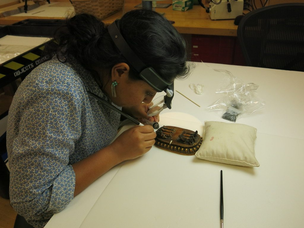 2.Mandira Chhabra—formerly ChhatrapatiShivajiMaharajVastuSangrahalaya (CSMVS) and Himalayan Society for Heritage and Art Conservation, Mumbai, currently graduate student at the Courtauld Institute, London—while examining the base of a gilded and painted stucco figure of Vajrabhairava from Mongolia. During her tenure at the Metropolitan Museum, Ms Chhabra focused on decorated surfaces, incorporating both high and low tech investigative methods for examining, documenting, and treating Asian works of art.