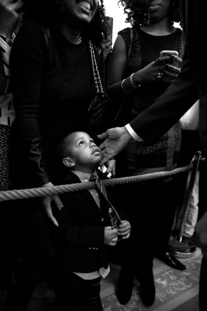 """1. """"I had my eye on this youngster while President Barack Obama spoke during a reception at the White House celebrating African American History Month. When the President starting greeting audience members along the rope line, I bent down in front of the young man and captured this moment of the President touching his face before he too bent down to greet him. Afterwards, I tracked down his name—Clark Reynolds—and had the President sign a copy for him."""" (Official White House Photo by Pete Souza)"""
