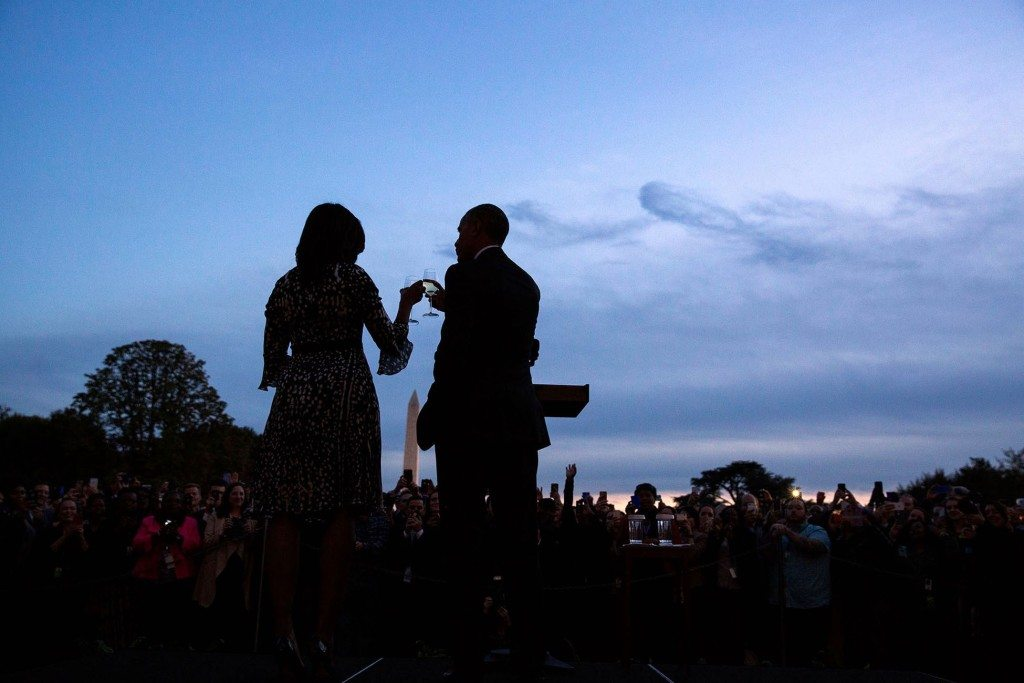 """""""There was almost no light remaining at the end of the day when the President and First Lady walked out to the South Lawn for a 'Fourth Quarter' toast to White House staff."""" (Official White House Photo by Pete Souza)"""