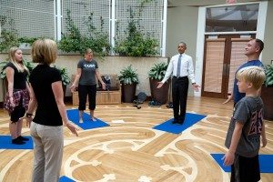 """9. Aug. 26, 2016 """"While visiting service members receiving therapy at the Walter Reed National Military Medical Center, Master Chief Petty Officer David Hall asked the President if he would join him and his family in a yoga therapy session at the National Intrepid Center of Excellence. Master Chief Petty Officer Hall of the SEAL, Naval Air Station Ocean, Va., was injured while deployed to Iraq and Afghanistan, where he suffered multiple Traumatic Brain Injuries. He has served in the Navy for 26 years and has deployed five times."""" (Official White House Photo by Pete Souza)"""