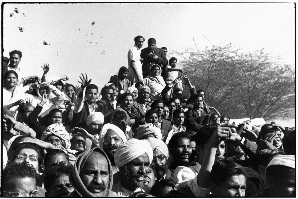 Delhi, India Gandhi's funeral. 1948. Crowds gathered between Birla House and the cremation ground, throwing flowers.