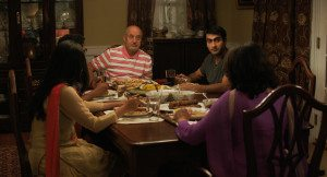 The Nanjiani Family at dinner in 'The Big Sick'