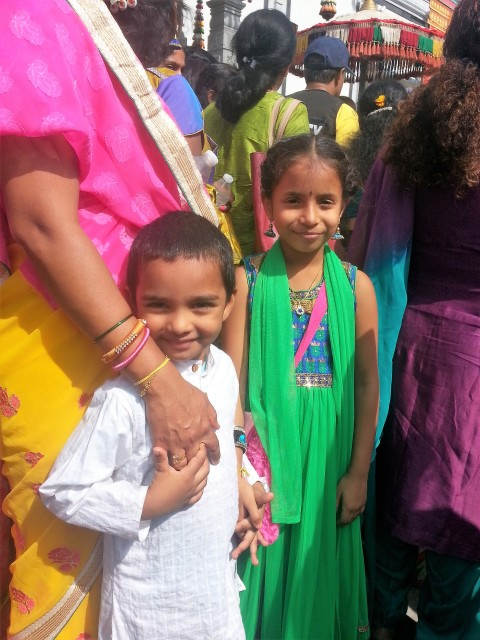 Happiness is mom's hand at the Ganesha Festival