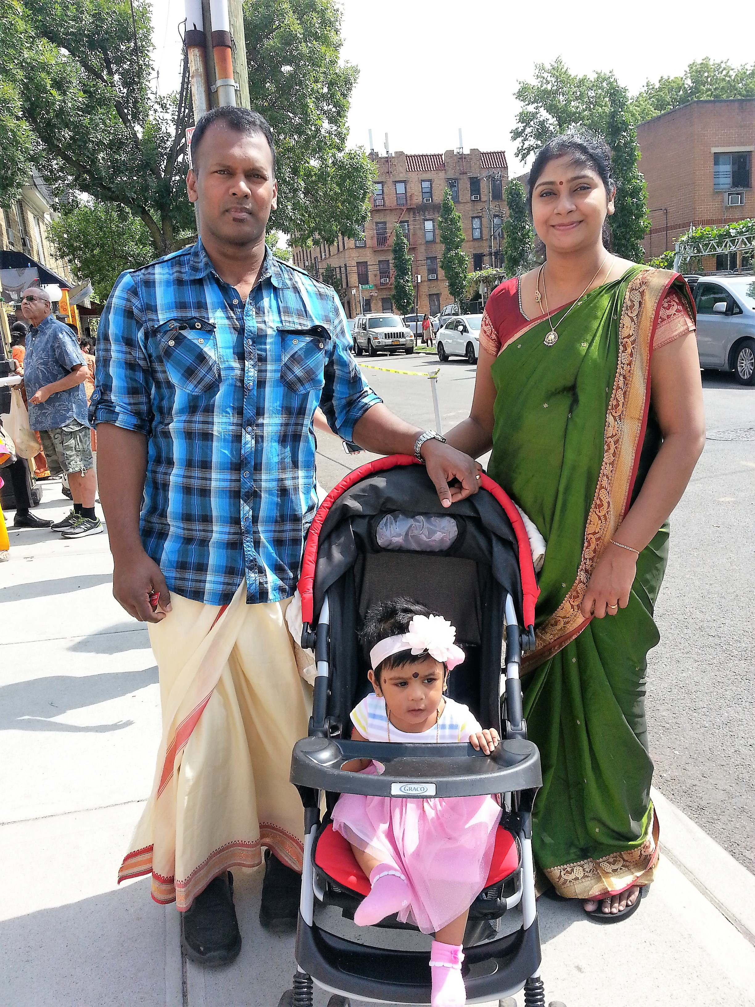 A couple from Sri Lanka celebrating baby's first visit to the Ganesha Festival