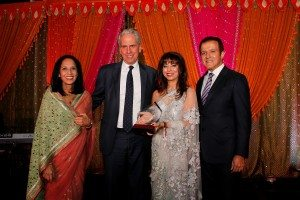 Bob Roth is presented the Making A Difference Award by Maya Rajani and Poonam and AJ Khubani of Telebrands, sponsor of the award.