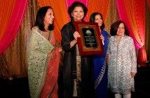 Chandrika Tandon receives the Lotus Award, flanked by Maya Rajani, Children's Hope India president, Tinku Jain, master of ceremonies, and Lavina Melwani, Children's Hope India co-founder.